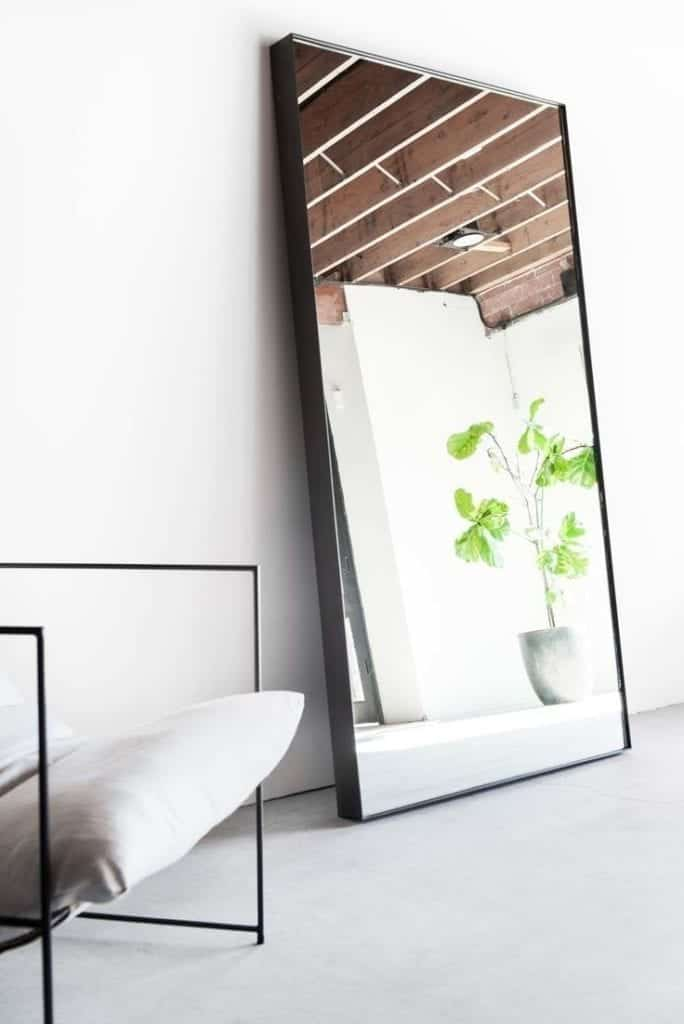 Big modern wall mirrors are very popular in living rooms