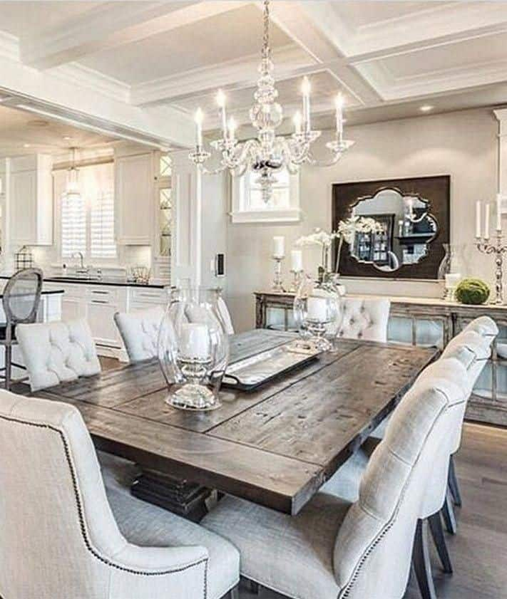 Chandelier and big wall mirror are creating two focal points in this dining room example