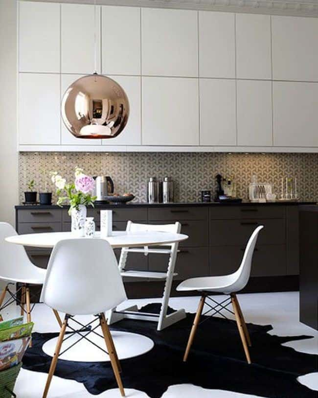 Scale and proportion between light and table in dining room interior design
