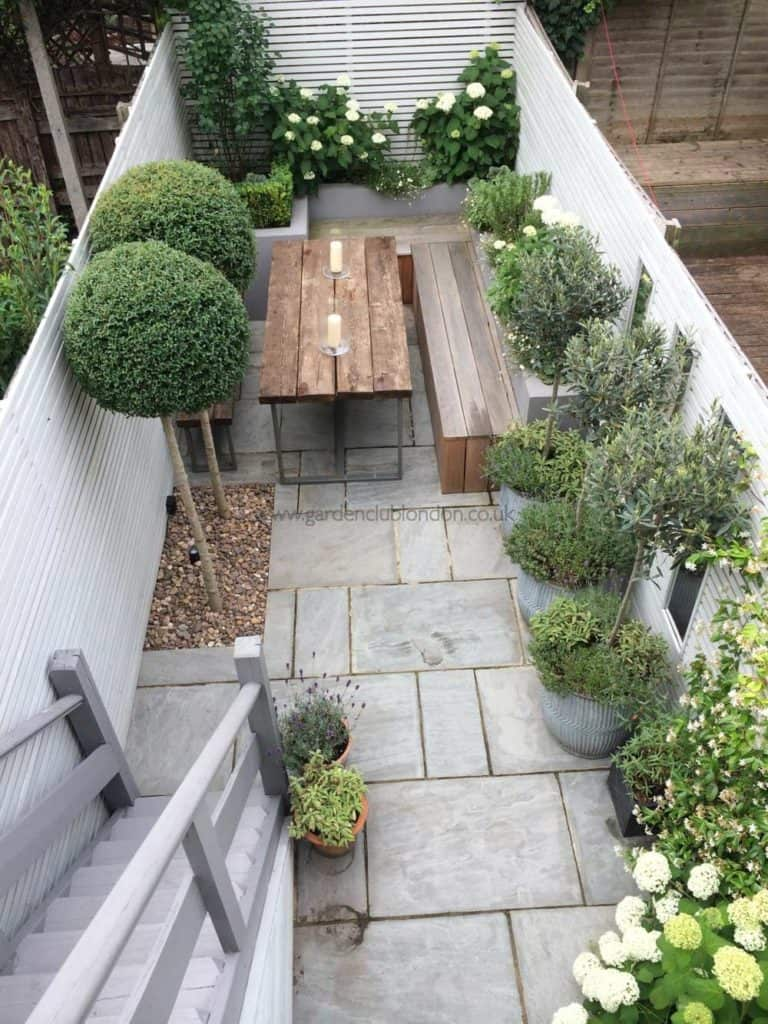Contemporary balcony garden design | concrete and wood mixture