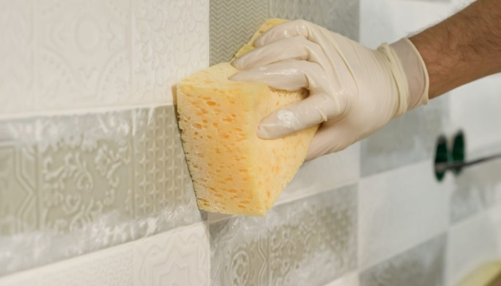 Apply a wet sponge to the tiles about 15-30 minutes after the application of the grout.