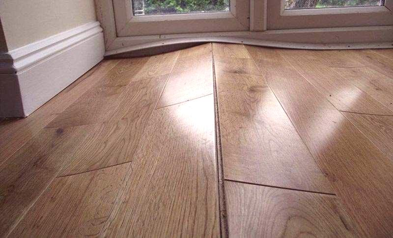 How to fix buckling laminate flooring?