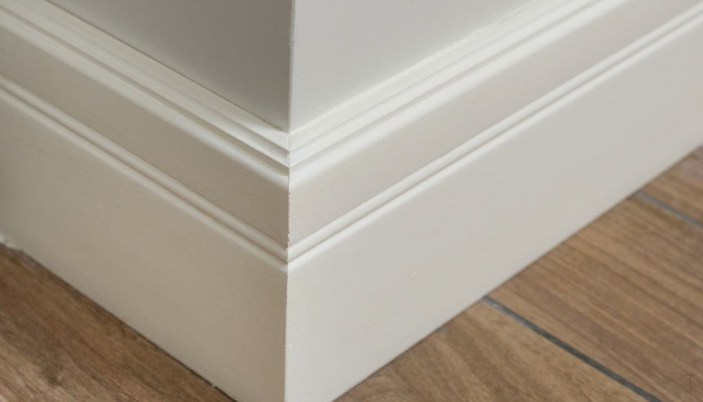protecting baseboards from vacuum scuff marks